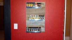 Spice Rack for the Kitchen cost about 18 dollars to make using old pallet boards and inside kitchen cabinet shelves.