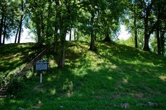 """The 43-foot high """"Prehistoric Mound"""" is located near the Port of Florence. The information on the historical marker says that the mound was probably built by the ancient people of the Woodland Culture."""