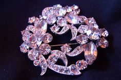 SOLD : Signed Eisenberg Ice Brooch, known for the use of Swarovski crystals as well as superior craftsmanship and attention to detail, Eisenberg & Sons