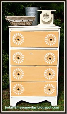 stenciled sunburst dresser- little too pale for me, but I like the sunburst idea!