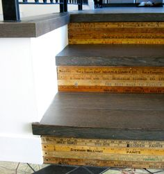 recycled / repurposed rulers for creative stairs.   Very cool idea. At first I thought there was writing decoupaged on the stairs. I'd loved to decoupage quotes & art on a staircase.