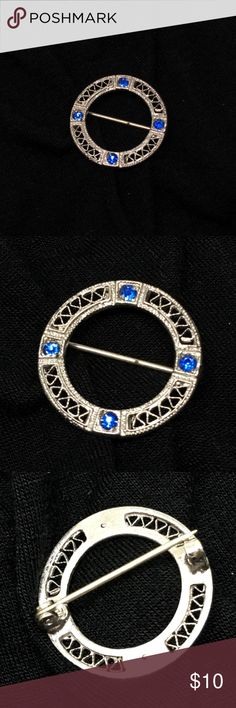 """Vintage Petite Silver and Blue Rhinestone Pin A 3/4"""" in diameter pin with delicate lattice and 4 perfect royal blue rhinestones. In excellent vintage condition. Not marked, but I suspect that this is Sterling silver. Cleans beautifully. Vintage Jewelry Brooches"""