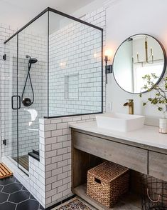 Loveee this clean modern bathroom with solid glass shower & subway tiles to the ceiling - the black frame is perfect!