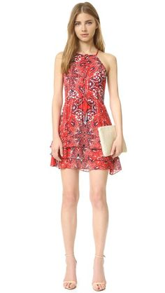 A lightweight Parker mini dress with a paisley print and a tiered skirt. Decorative ties detail the neckline. Sleeveless. Hidden back zip. Lined.