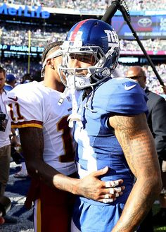 DeSean Jackson of the Washington Redskins and Odell Beckham Jr #13 of the New York Giants talk at the end of the game at MetLife Stadium on September...