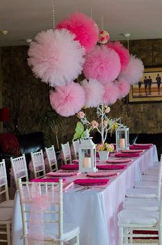 Pink baby shower centerpiece. Tulle poms, lanterns and flower-branches