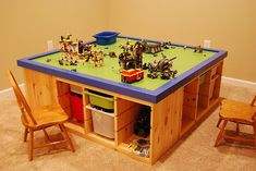 """Lego ikea hack..  4 slotted storage units fro IKEA. bins from IKEA.  plywood cut 4'8"""". round edges 1/8"""" sander, primed white, painted and laid lego base on top. http://m.flickr.com/#/photos/rb3wreath/4216365553/"""