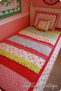 Strip quilt pattern available on Etsy.  This would be easy to make and I love the rick rack embellishments
