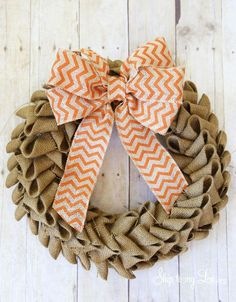 Gearing up for fall with a Burlap Wreath. It is a super easy fall decoration for your home.  Burlap Wreath Supplies 1 1/2 yards burlap spool of burlap ribbon for bow 200 floral pins (greening pins) 1 straw wreath How to make a burlap wreath First cut about a 3 to 4 inch long strip of burlap to wrap around the wreath. Fasten off with a greening pin. Cut...