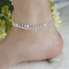"""- 4 Row Anklet - 3 rows of chains and 1 row of crystal makes this a very sexy anklet. - Lobster claw clasp - 2"""" extension"""