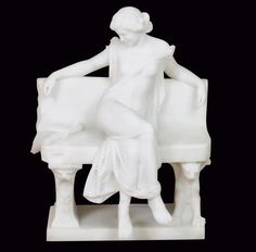 A. Frilli marble statue of a woman on a bench.