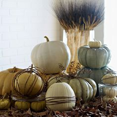 Mix things up with yellow, white and gray pumpkins! More fall decorating: http://www.bhg.com/halloween/outdoor-decorations/gourds-pumpkins-uses/?socsrc=bhgpin092313graypumpkins&page=24