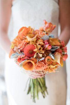 Gorgeous, unique and elegant bridal wedding bouquet in a palette of orange.