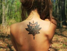 Lotus mandala! This would be a nice rib/back tat. Only I'd leave out the dots above and below.