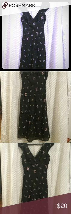 Speechless midi butterfly dress Black with pick, blue, and yellow multi-colores butterflies. It is lace trimmed. The lace around neck is stretched a little ( see pictures). The neckline is a v neck that is mirrored on the back. Cute spring  and summer dress. Speechless Dresses Midi