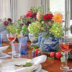 The Centerpiece | Tried & True Thanksgiving  Fill various shapes and sizes of blue-and-white vessels, such as pitchers and ginger jars, with abundant bouquets of garden flowers, and then stagger them down the table.