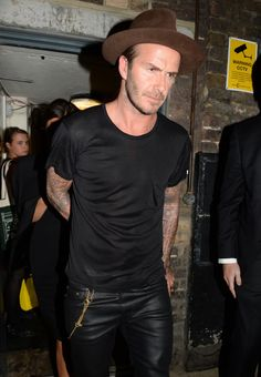 Style Watch: David Beckham Rocks the Fedora/ were we not going to talk about the leather pants, or