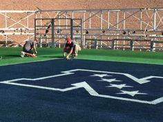 Turf student and winner of Toro's Super Bowl Sports Turf Training Program helps paint the field for Super Bowl XLIX