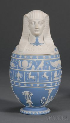 Wedgwood Light Blue Jasper Dip Canopic Jar and Cover, England, early 19th century, applied white relief bands of hieroglyphs and zodiac symbols above Egyptian motifs.
