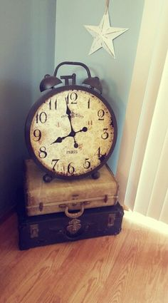 Rustic decor with old suitcases and clock