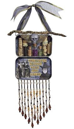 Altered tin - this could be great as a protection charm combo for someone's front door...