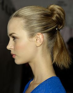 The ponytail-meets-bun look at Marc Jacobs created serious buzz in the beauty press. To achieve it, sweep hair back high and off the face (no part necessary). Flip the ponytail forward and pin with a thin clip about two inches from the base. Then flip the ponytail back down toward the nape of the neck and secure with a second clip to create the playful bump.