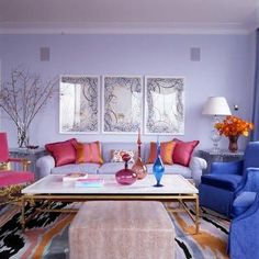 Pretty room, lavender walls with blue, pink, and tangerine...it's a color feast! Fabulous coffee table.
