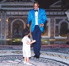 Jay Z dances with daughter Blue Ivy Carter at the Miami New Year's Eve bash.