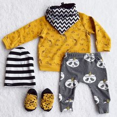 It's #flatlay time. We're bringing some fantastic #handmade #babyfashion together with this @johnlewis dino jumper. All for the love of #yellow! Ahhh  Matching in with the jumper and also mirroring the dino spots we have these #funky little cheetah #babybooties by @harperblue These booties are just the coolest things I've ever seen and they stay on too! I'm forever loosing booties - but not these bad boys. They also resemble #babyhitops which really does tick a big box for me. Next we've…