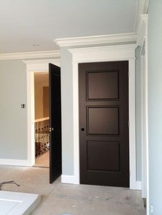 Dark doors, white trim and crown molding over each door. This will be the look in my home. :) Dark doors, white trim and crown molding over each door. This will be the look in my home. Dark Doors, Brown Doors, The Doors, Entry Doors, White Trim Wood Doors, Wood Trim, Exterior Doors, Exterior Paint, Entryway