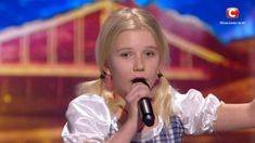The three judges for Ukraine's Got Talent had no idea what to expect when a little blond girl bounced onto the stage. The girl was wearing a checkered dress that was blue and white in color. Little Blonde Girl, Little Girls, Ukraine, Transformers, Funky Shoes, Dance Routines, Country Songs, All About Eyes, The Funny