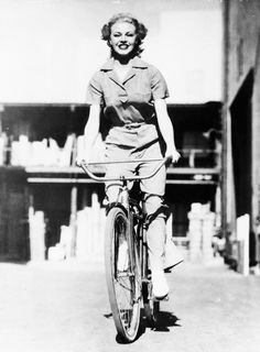 Ginger Rogers riding a bicycle, 1935.