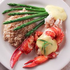"""Maine Lobster with fresh lump crabmeat, tender asparagus and creamy Bearnaise sauce. Lobster Oscar is a great way to """"fancy-up"""" lobster!"""