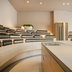 Aesop interior in Dusseldorf, Germany by Snøhetta. Pay attention to the way they arrange the bottles along side with other objects.