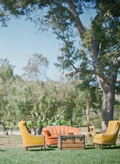 Rustic vintage wedding lounge - what if we bought some thrift store sofas, etc and set them up outside??