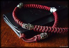Two-strand wall knot sinnet 425 paracord wallet lanyard with Spartan beads from Schmuckatelli Co.