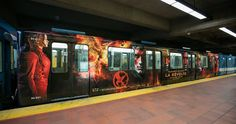How cool is THIS?! Canadian tributes in Montreal, be on the lookout for an amazing Mockingjay Part 2 metro train! Hunger Games le film posted these pics with the caption (I'm translating from French). Notice to all the rebels! At This moment, in The Hunger Games train, on the green line of the Montreal metro: 1000 copies of Mockingjay will be given away while supplies last! #larévolte is alive in the Montreal metro!