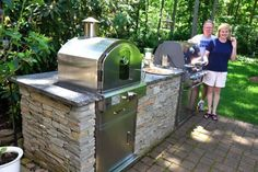 """Outdoor kitchens offer entertaining options. Bob Roth had your basic Weber grill on a small patio in his Allendale backyard. He wanted more. Now he's got a 10-foot-long barbecue island with a built-in grill and a built-in pizza oven, surrounded by granite countertops and stone veneer on the sides of the island. """"We thought the…"""