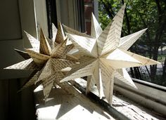 Gorgeous three dimensional stars created from old book pages.