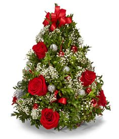 Oh Christmas Tree! This beautiful tree shaped arrangement made with fresh greens, red roses, and festive ornaments is a fabulous gift sure to bring smiles all season long. Perfect for a friend or loved one, colleague or client - send this gift today and make it a perfect start to their Holiday season. Includes: * Red Roses * White Babies Breath * Seasonal Greens * Mini Silver Ornaments * Decorative Red Ribbon