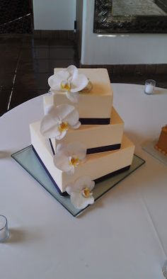 Simple, elegant, square 4-tier buttercream wedding cake with ribbon and fresh orchids by Cherron K. (Santa Fe, NM)