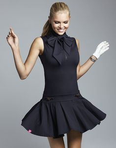 This flirty dress is a must-have to be seen on the tennis court! Drop waistline accentuates the female form and is topped off with a dramatic tie for the neck. Underneath this sexy tie lies a zipper f