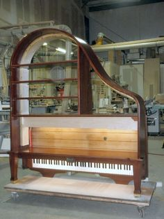 Repurpose a Baby Grand Piano into a massive bookshelf . Put a baby grand piano back … Piano Art, Piano Room, Old Pianos, Baby Grand Pianos, Upright Piano, Repurposed Furniture, Bookshelves, Shelving, Architecture Design