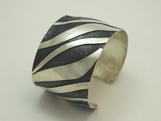 Cuff | Dennis Higgins. 'Zebra'.  Sterling silver with patina.