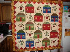 Farmhouse Quilt.  what a great looking quilt, strips and applique.  Peace, Robert from nancysfabrics.com