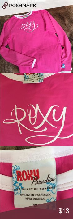 ROXY Girl's Pink Beach/Play Top This cute perfect like new pink top trimmed in white with the Roxy logo is just what your preteen wants! Pullover and smooth easy care Polyester. Roxy Shirts & Tops Tees - Long Sleeve