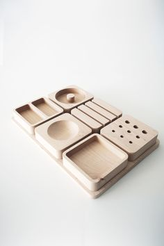 cnc milled from hard maple, a simple alignment tray allows the user to plug-and-play different units of organization to suit their desktop clutter needs