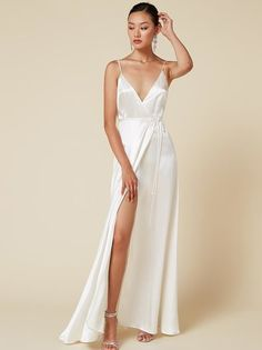 Fine, I do. This is a floor length, wrap dress with a low v neckline, high slit and adjustable straps.