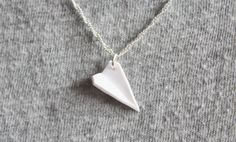 This clay airplane is so simple yet makes for a lovely, delicate necklace. Share with me photos of your charms by . Polymer Clay Ornaments, Polymer Clay Christmas, Polymer Clay Canes, Polymer Clay Necklace, Polymer Clay Projects, Diy Clay, Handmade Polymer Clay, Polymer Clay Animals, Clay Charms