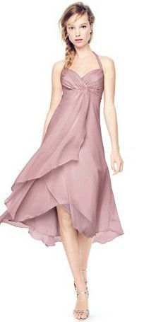 Exceptionally beautiful and ultra-feminine, this crinkle chiffon bridesmaid dress is perfect for any affair! A halter bodice features an empire waist with dazzling beaded detail, while a high-low hem is perfect for any wedding. David's Bridal Bridesmaid Dress Style F15417.